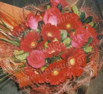 Bouquet of red roses and red gerberas